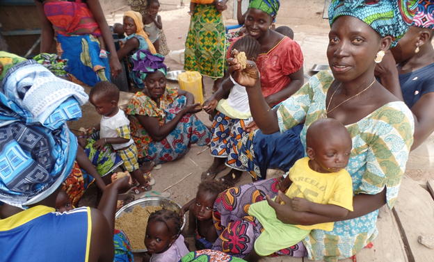A family eating Benechin (local dish) in Ndawen Village, Central River Region, The Gambia